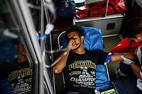"""Un hombre joven es atendido por paramédicos abordo de una ambulancia de la cruz roja mexicana, presenta problemas de deshidratación causados por la falta de líquidos y el calor del desierto sonorense. <br /> <br /> La Caravana del Migrante conformada por un contingente de 600 personas su mayoría de origen centroamericano, arribaron a Hermosillo a bordo del tren conocido como """"La Bestia"""", provienen de la frontera Sur del País y con rumbo a la ciudad de Mexicali donde continuaran el viaje hasta Tijuana.<br /> La caravana tiene como objetivo solicitar <br /> asilo a Estados Unidos y algunos integrantes piensan solicitar una visa humanitaria en Mexico para laborar en los campos de Sonora y Baja California.<br /> (Photo: NortePhoto/Luis Gutierrez)"""