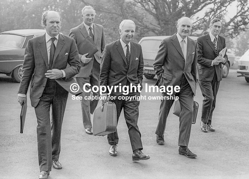 Ulster Unionist Party delegation headed by Brian Faulkner, centre, arrives at Stormont Castle for discussions on the formation of a power-sharing executive under the chairmanship of N Ireland Secretary of State, William Whitelaw. Others (from left) are Roy Bradford, Leslie Morrell, Herbert Kirk and Basil McIvor, 5th October 1973, 197310050625a<br /> <br /> Copyright Image from Victor Patterson, 54 Dorchester Park, <br /> Belfast, UK, BT9 6RJ<br /> <br /> t1: +44 28 9066 1296 (from Rep of Ireland 048 9066 1296)<br /> t2: +44 28 9002 2446 (from Rep of Ireland 048 9002 2446)<br /> m: +44 7802 353836<br /> <br /> e1: victorpatterson@me.com<br /> e2: victorpatterson@gmail.com<br /> <br /> www.victorpatterson.com<br /> <br /> Please see my Terms and Conditions of Use at VICTORPATTERSON.COM. It is IMPORTANT that you familiarise yourself with them.<br /> <br /> Images used on the Internet must be visibly watermarked i.e. &copy;VICTORPATTERSON.COM within the body of the image and copyright metadata must not be deleted. Images used on the Internet have a size restriction of 4kbs and are chargeable at the then current NUJ rates.<br /> <br /> This image is only available for the use of the download recipient i.e. television station, newspaper, magazine, book publisher, etc, and must not be passed on to any third party. It is also downloaded on condition that each and every usage is notified within 7 days to victorpatterson@me.com<br /> <br /> The right of Victor Patterson to be identified as the author is asserted in accordance with The Copyright Designs And Patents Act (1988).