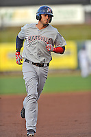 Huntsville Stars first baseman Nick Ramirez #9 rounds the bases after hitting a home run during a game against Tennessee Smokies at Smokies Park on April 25, 2014 in Kodak, Tennessee. The Stars defeated the Smokies 15-1. (Tony Farlow/Four Seam Images)