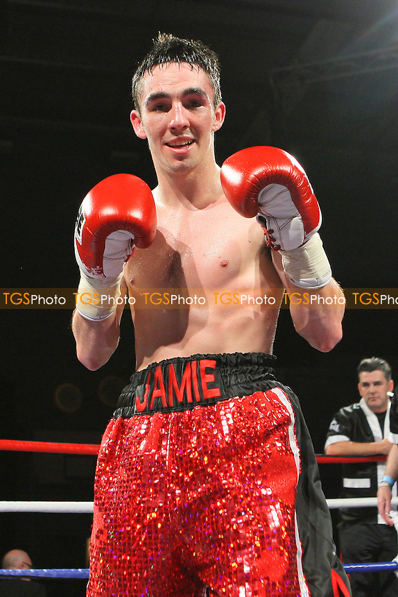 Jamie Conlon (red/black shorts) defeats Kyle King (white shorts) in a Bantamweight boxing contest at Medway Park, Gillingham, promoted by Frank Maloney - 14/05/11 - MANDATORY CREDIT: Gavin Ellis/TGSPHOTO - Self billing applies where appropriate - Tel: 0845 094 6026
