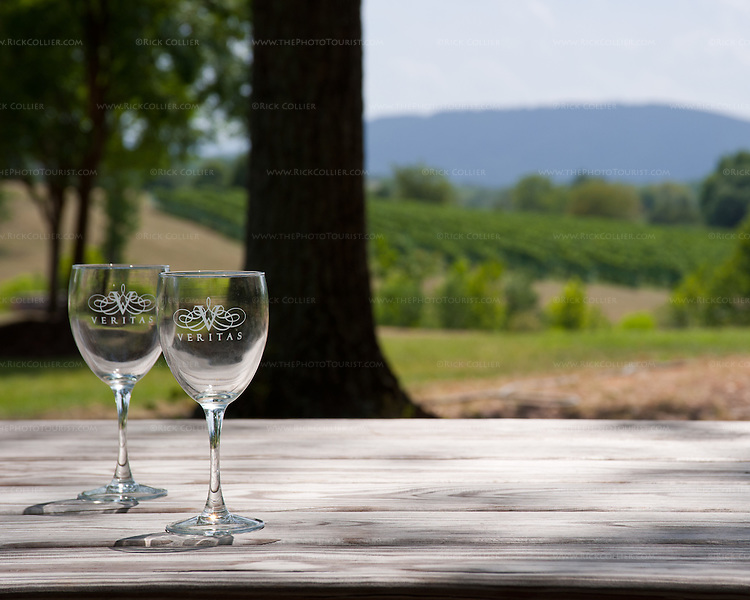 Abandoned wine glasses on a shaded picnic table in the woods at Veritas Vineyards.
