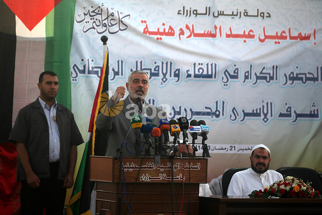 Palestinian Prime Minister in Gaza Strip, Ismail Haniyeh, breaks his fast with a Palestinian released Prisoners during the holy month of Ramadan, in Gaza city on 09 August 2012. Photo by Majdi Fathi