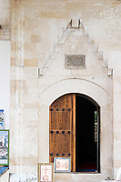The entrance portico to the mosque. Pocitelj historic Muslim and Christian village near Mostar. Federation Bosne i Hercegovine. Bosnia Herzegovina, Europe.