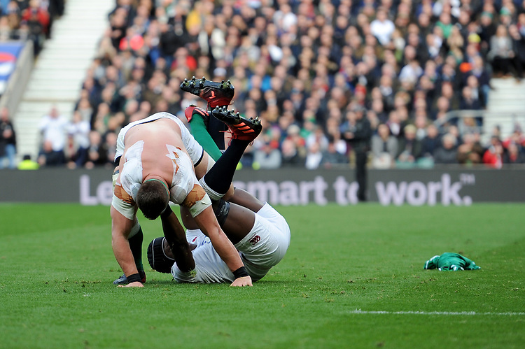 CJ Stander of Ireland loses his shirt as he tussles with Maro Itoje of England during the Guinness Six Nations match between England and Ireland at Twickenham Stadium on Sunday 23rd February 2020 (Photo by Rob Munro/Stewart Communications)