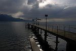 Pier under stormy clouds on lake Léman, Vevay, close to Montreux,Lausanne, Switzerland.