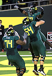 10/02/10-- Oregon wide receiver D.J.Davis is lifted by teammate by Jordan Holmes (54) after scoring a touchdown in the second half at Autzen Stadium in Eugene, Or..Photo by Jaime Valdez.....