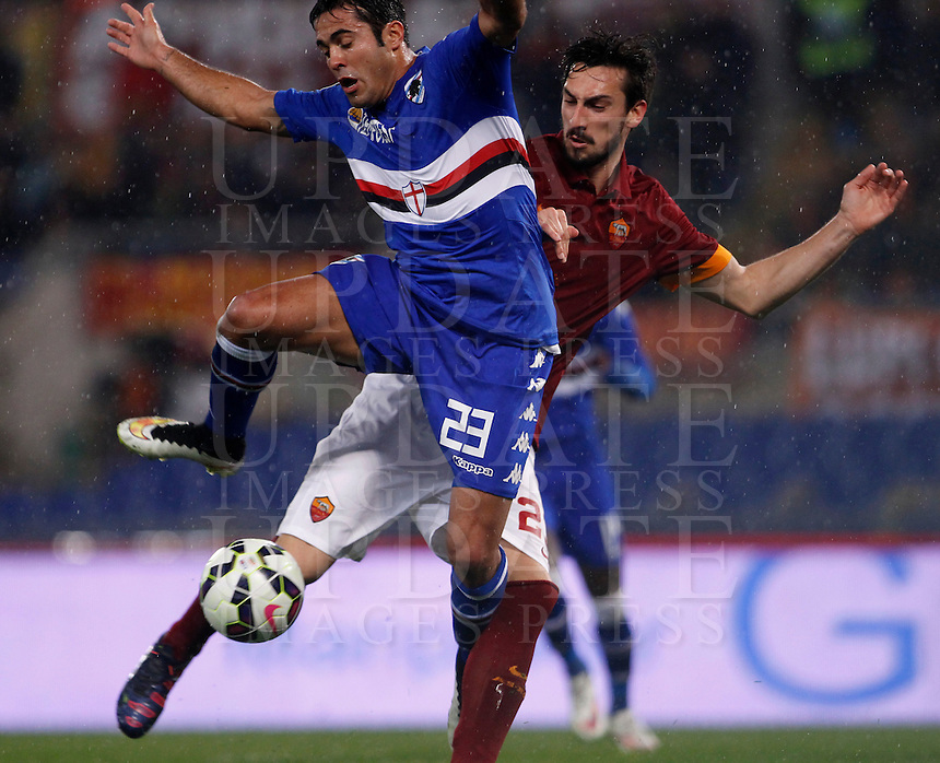 Calcio, Serie A: Roma vs Sampdoria. Roma, stadio Olimpico, 16 marzo 2015. <br /> Sampdoria&rsquo;s Eder, left, and Roma&rsquo;s Davide Astori fight for the ball during the Italian Serie A football match between Roma and Sampdoria at Rome's Olympic stadium, 16 March 2015.<br /> UPDATE IMAGES PRESS/Isabella Bonotto