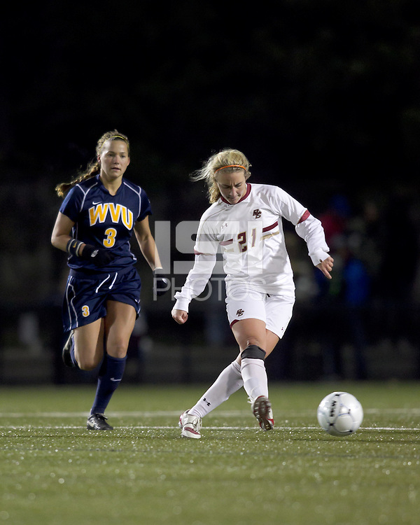 "Boston College midfielder Kate McCarthy (21) passes the ball. Boston College defeated West Virginia, 4-0, in NCAA tournament ""Sweet 16"" match at Newton Soccer Field, Newton, MA."