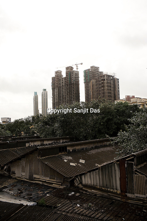 Skyscraper apartments in comparison to the old houses in the foreground are seen in the financial capital, Mumbai.