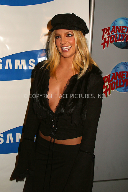 "Britney Spears arrives at Planet Hollywood in New York for the press conference to announce her bood ""Stages."" ..The book, accompained by DVD, gives Britney's fans an ultimate view of the person behind the superstar glitz...The book is compiled of photography, video and Britney's personal reminiscences. Britney's family members and friends took active part in creating ""Stages."" New York, December 6, 2002. Please byline: Alecsey Boldeskul/NY Photo Press.   ..*PAY-PER-USE*      ....NY Photo Press:  ..phone (646) 267-6913;   ..e-mail: info@nyphotopress.com"