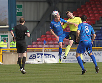 Jason Naismith beats James Vincent in the air in the Inverness Caledonian Thistle v St Mirren Scottish Professional Football League Premiership match played at the Tulloch Caledonian Stadium, Inverness on 29.3.14.