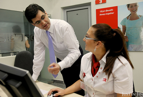 VivaCell- Armenia CEO Ralph Yirikian talks to a service center worker at his office headquarters in Yerevan, the capital of Armenia.
