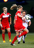 BOYDS, MARYLAND - April 06, 2013:  Hayley Siegel (17) of The Washington Spirit juggles the ball in front of Danielle DeLisle (28) of the University of Virginia women's soccer team in a NWSL (National Women's Soccer League) pre season exhibition game at Maryland Soccerplex in Boyds, Maryland on April 06. Virginia won 6-3.