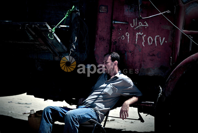 Palestinian man sits at a chair in the main market in Gaza city on June 24,2010. Photo by Mustafa Hassona
