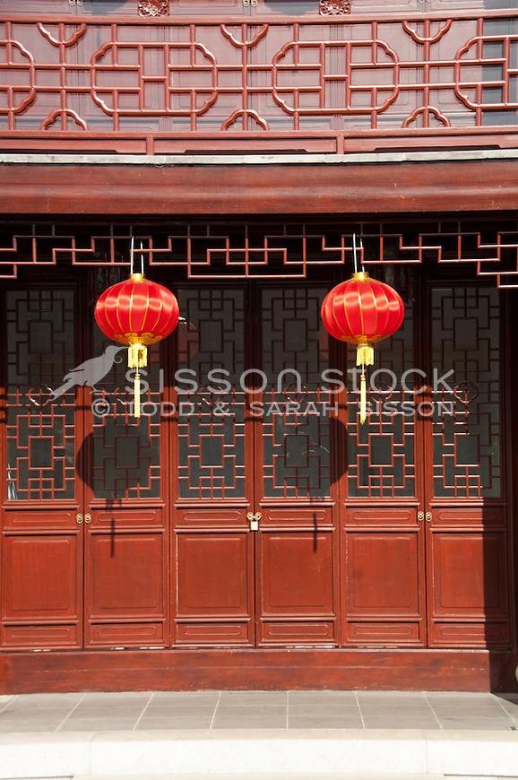 Vivid Red lanterns hang outside the traditional Tea house with it's ornate lattice work at the Dunedin Chinese Gardens, Otago, South Island, New Zealand - stock photo, canvas, fine art print
