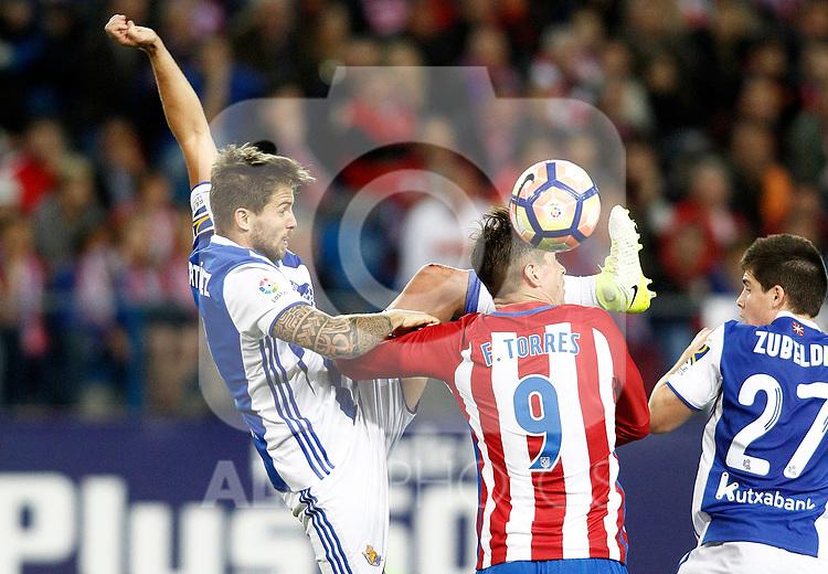 Atletico de Madrid's Fernando Torres (c) and Real Sociedad's Inigo Martinez (l) and Igor Zubeldia during La Liga match. April 4,2017. (ALTERPHOTOS/Acero)