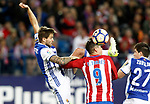 Atletico de Madrid's Fernando Torres (c) and Real Sociedad's Inigo Martinez (l) and Igor Zubeldia during La Liga match. April 4,2017. (ALTERPHOTOS/Acero)