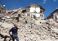 An Italian Police officer observes rubble of collapsed buildings in the village of Amatrice, central Italy, hit by a magnitude 6 earthquake at 3,36 am, 24 August 2016.<br /> Un poliziotto tra le macerie degli edifici crollati dopo il terremoto che alle 3,36 del mattino ha colpito Amatrice, 24 agosto 2016.<br /> UPDATE IMAGES PRESS/Riccardo De Luca