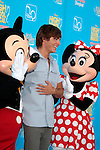 Zac Efron and Mickey and Minnie.Photo by Nina Prommer/Milestone Photo