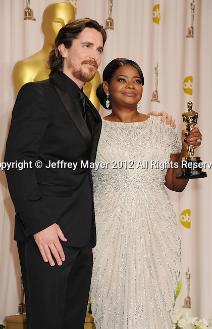 HOLLYWOOD, CA - FEBRUARY 26: Christian Bale and Octavia Spencer  pose in the press room at the 84th Annual Academy Awards held at Hollywood & Highland Center on February 26, 2012 in Hollywood, California.