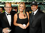 From left: George Postolos, Melissa Lima and Roberto Clemente Jr. at the Astros Wives' Gala at Minute Maid Park Thursday Aug. 16, 2012.(Dave Rossman/For the Chronicle)