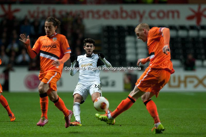 Thursday 28 November  2013  Pictured:Alejandro Pozuelo tries to break the valencia defence<br /> Re:UEFA Europa League, Swansea City FC vs Valencia CF  at the Liberty Staduim Swansea