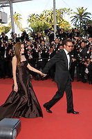 ANGELINA JOLIE &amp; BRAD PITT<br /> 'The Tree of Life' premiere at the Palais des Festival, 64th International Cannes Film Festival, France<br /> 16th May 2011<br /> full length strapless silk satin brown dress gown black tux tuxedo tinted glasses sunglasses shades couple gathered goatee facial hair hand arm side profile holding hands photographers press<br /> CAP/PL<br /> &copy;Phil Loftus/Capital Pictures /MediaPunch ***NORTH AND SOUTH AMERICAS ONLY***