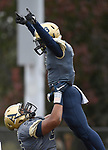 Althoff running back Richard Cosey (3) is hoisted aloft by teammate Jordyn Slaughter (66) after scoring a touchdown in the first half. The Althoff Catholic High School Crusaders defeated the Carterville Lions 42-0 in a first-round Illinois High School Association Class 4A football playoff game on Saturday October 28, 2017 in Belleville.