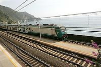 Un treno in transito alla stazione di Corniglia, uno dei borghi delle Cinque Terre.<br /> A train passes through the station of Corniglia at the Cinque Terre.<br /> UPDATE IMAGES PRESS/Riccardo De Luca