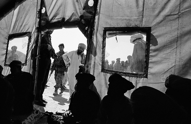A refugee camp near Kandahar, US forces and Afghan Forces searching for Taliban. September 29th 2005.