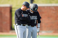 Coastal Carolina Chanticleers head coach Gary Gilmore (14) has a chat with Michael Paez (1) during the game against the High Point Panthers at Willard Stadium on March 15, 2014 in High Point, North Carolina.  The Chanticleers defeated the Panthers 1-0 in the first game of a double-header.  (Brian Westerholt/Four Seam Images)
