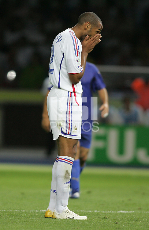 French forward (12) Thierry Henry reacts to a missed shot.  Italy defeated France on penalty kicks after leaving the score tied, 1-1, in regulation time in the FIFA World Cup final match at Olympic Stadium in Berlin, Germany, July 9, 2006.