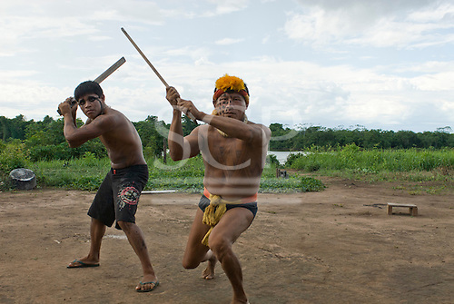 Xingu Indigenous Park, Mato Grosso State, Brazil. Aldeia Morena. Yawapi Kamaiura (R). Kamaiura Indians showing their anger at the construction of the dam.