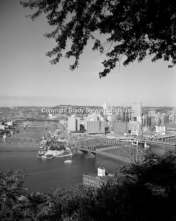 Pittsburgh PA:  View of Pittsburgh with the Gateway Clipper taking passengers around the Point near the Pittsburgh Symphony stage - 1959