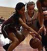 Alexa Marigliano #11 of Plainedge, right, and Brianna Guillen #15 of Glen Cove battle for possession during a Nassau AA-3 girls basketball game at Plainedge High School on Thursday, Dec. 20, 2018.