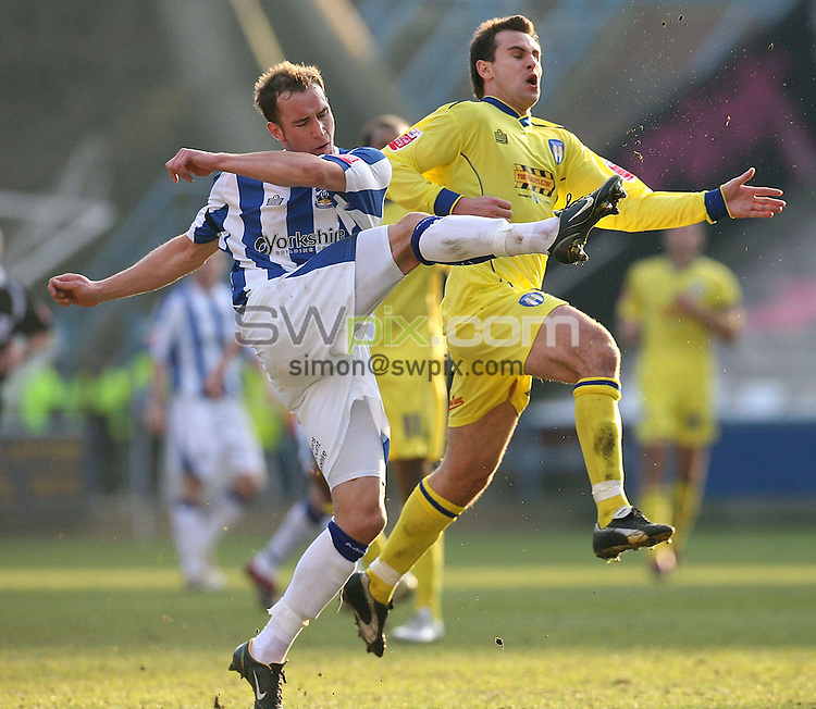 Pix by JOHN CLIFTON/SWpix.com -  Coca Cola League One, Huddersfield Town v Colchester United, The Galpharm Stadium, Huddersfield, 11/02/06..Picture Copyright >> Simon Wilkinson >> 07811267706..Huddersfield's David Mirfin clears the ball from Colchester's Richard Garcia
