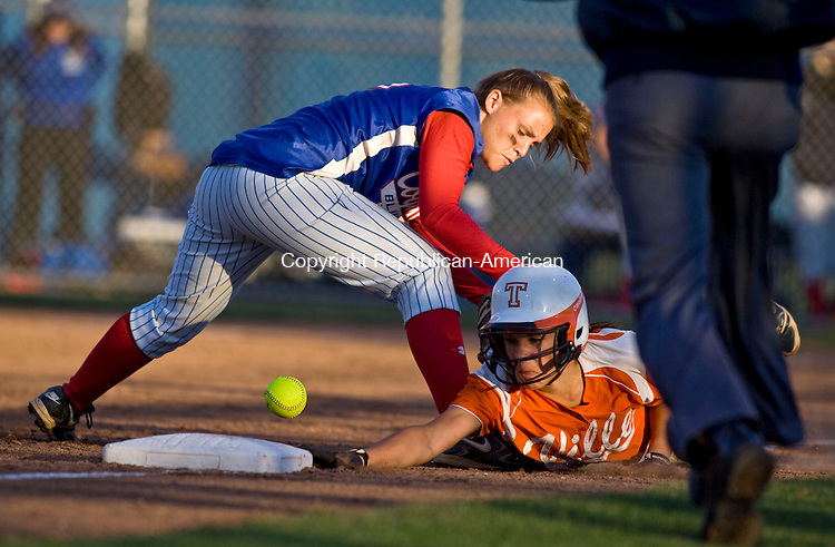WEST HAVEN, CT - 08 JUNE 2010 -060810JT07-<br /> Terryville's Devan Embleton is safe at third as Coginchaug's Elizabeth Sansevero missed a throw during Tuesday's Class S semifinal game at West Haven. In the foreground is umpire Rich Calitro. Terryville won, 2-0.<br /> Josalee Thrift Republican-American