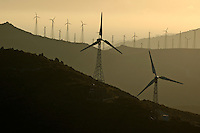Wind turbine on a ridge at sunset, Tarifa, Andalusia, Spain.