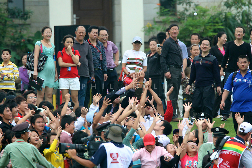 Local fans in action during the final round of the Omega Mission Hills World Cup played at The Blackstone Course, Mission Hills Golf Club on November 27th in Haikou, Hainan Island, China.( Picture Credit / Phil Inglis )