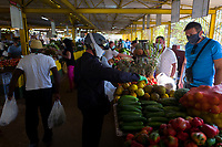 HAVANA, CUBA - MARCH 24: People wear face masks at the market to prevent the spread of COVID-19, on March 24, 2020. The World Health Organization declared a global pandemic as the coronavirus rapidly spreads across the world. (Photo by Eliana Aponte/VIEWpress/Corbis via Getty Images)