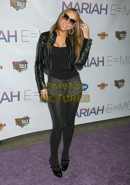 "MARIAH CAREY.Mariah Carey ""E=MC2"" CD Signing held at Universal CityWalk, Universal City, California, USA..April 17th, 2008.full length black leather jacket tights shorts top striped stripes shorts  sunglasses shades hand.CAP/ADM/RE.©Russ Elliot/AdMedia/Capital Pictures."