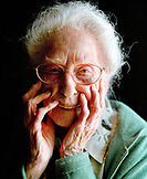 USA, California, Eureka, portrait of a 103 year old woman on a black background