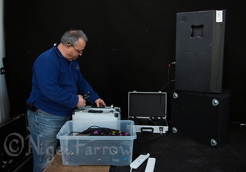 11 APR 2015 - STOWMARKET, GBR - John Peel Centre for Creative Arts sound engineer Phillip Radley prepares the microphones before the Larkin Poe gig in Stowmarket, Great Britain (PHOTO COPYRIGHT © 2015 NIGEL FARROW, ALL RIGHTS RESERVED)