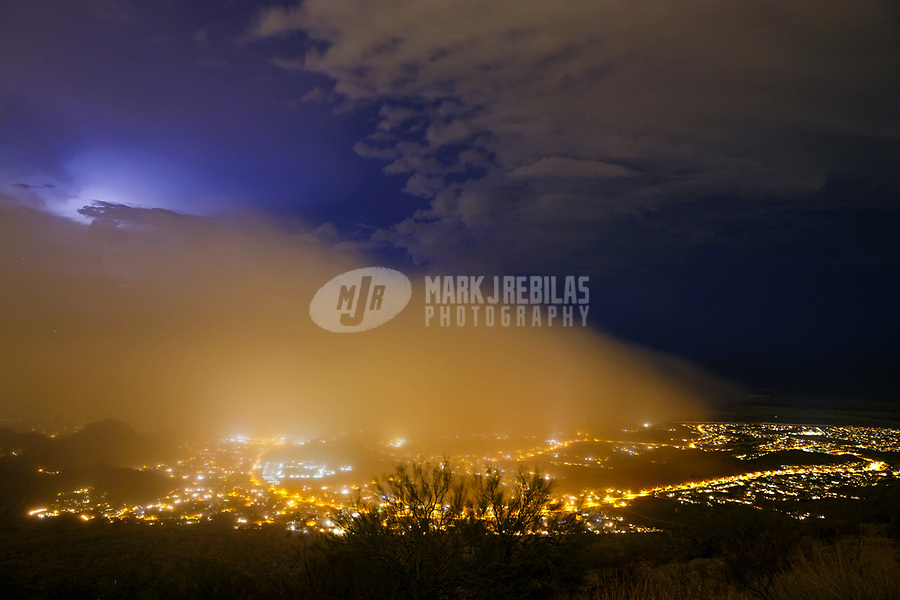 Jul 16, 2017; Phoenix, Arizona, USA;   A haboob dust storm approaches the Ahwatukee community at night as viewed from South Mountain during a summer monsoon thunderstorm. Mandatory Credit: Mark J. Rebilas