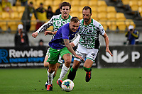 David Ball of Wellington Phoenix struggles to keep the ball from Andrew Durante of Western United FC during the A League - Wellington Phoenix v Western United FC at Sky Stadium, Wellington, New Zealand on Friday 21 February 2020. <br /> Photo by Masanori Udagawa. <br /> www.photowellington.photoshelter.com