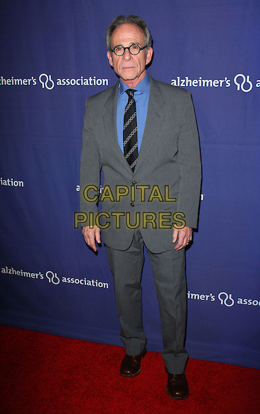 "RON RIFKIN.The Alzheimer's Association's 17th Annual ""A Night At Sardi's"" held at the Beverly Hilton Hotel, Beverly Hills, California, USA..March 4th, 2009.full length grey gray suit glasses .CAP/ADM/KB.©Kevan Brooks/AdMedia/Capital Pictures."
