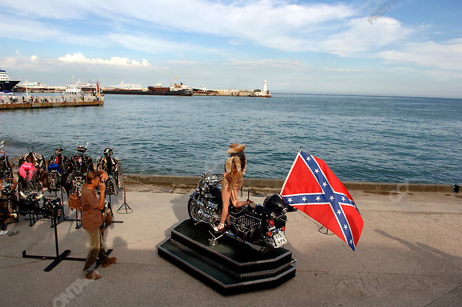 A woman poses for a photo on the seafront promenade. Yalta, Republic of Crimea, May 27, 2006.