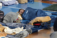 Pictured: A man -one of the hundreds of migrants- is sleeping on the floor in Ierapetra basketball arena. Friday 28 November 2014<br /> Re: 700 migrants aboard a ship that lost power in the Mediterranean Sea with and was towed into a Greek harbor are being housed in a basketball arena while their refugee status was assessed.<br /> It took the Greek navy four days to tow the ship Baris from international waters into Ierapetra harbor, on the Greek island of Crete. The vessel lost power in storm-force winds.<br /> Many are Syrians fleeing the civil war. A senior health official on the island, Panayiotis Efstathiou, said many would be released.