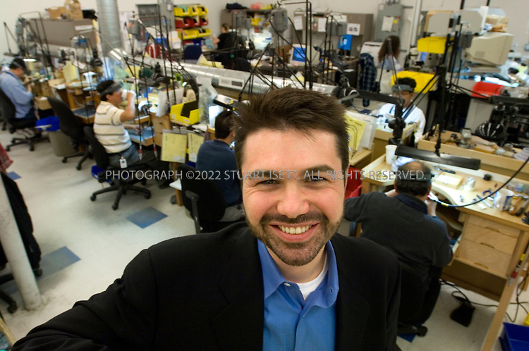 12/12/2006--Seattle, WA, USA..Mark Vadon, CEO of Blue Nile, posing in the company's Seattle wrokshop where workers polish and mount diamonds. Blue Nile (www.bluenile.com) sells expensive diamonds online from its base in Seattle...Photograph By Stuart Isett.All photographs ©2006 Stuart Isett.All rights reserved.
