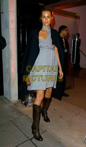 YASMIN LE BON.Attending the 6th Annual Lancome Colour Design Awards, . held at Linley Hall, Victoria, London, England, .November 28th 2006..full length black coat brown knee high boots grey dress lebon halterneck cut out.CAP/CAN.©Can Nguyen/Capital Pictures